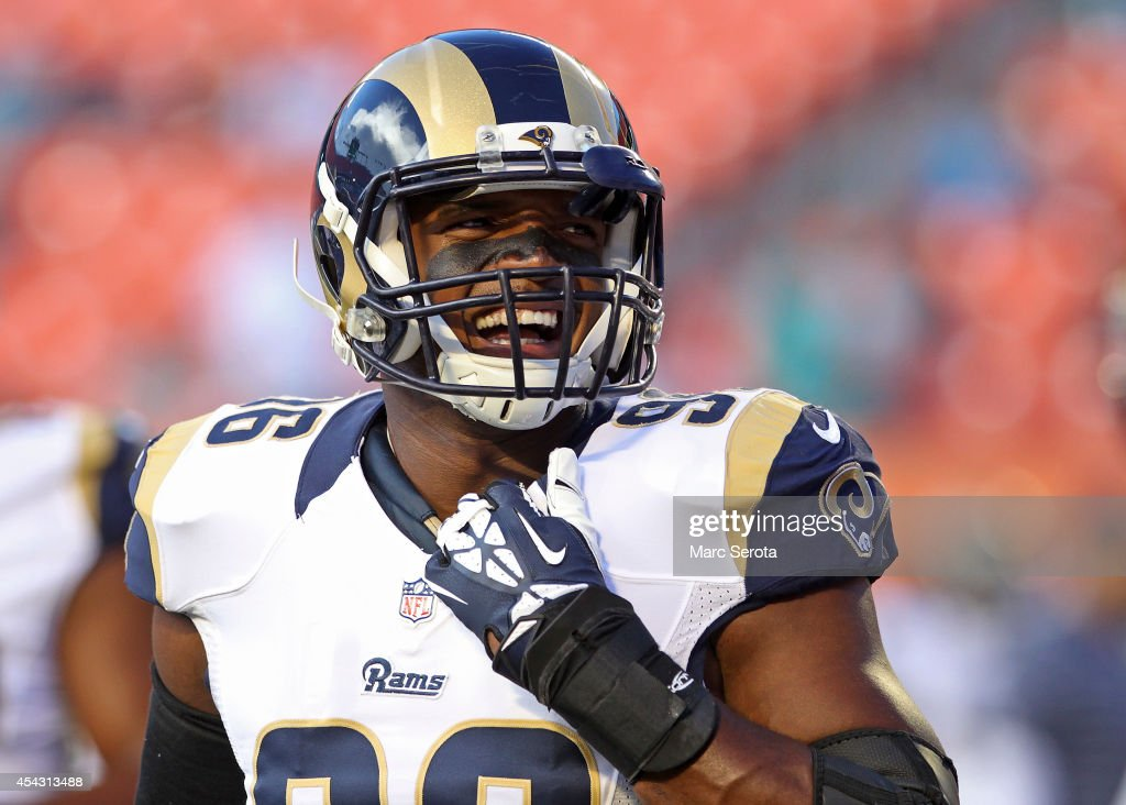 Defensive end <a gi-track='captionPersonalityLinkClicked' href=/galleries/search?phrase=Michael+Sam&family=editorial&specificpeople=7172674 ng-click='$event.stopPropagation()'>Michael Sam</a> #96 of the St. Louis Rams reacts during pregame workouts before his team met the Miami Dolphins at Sun Life Stadium on August 28, 2014 in Miami Gardens, Florida.