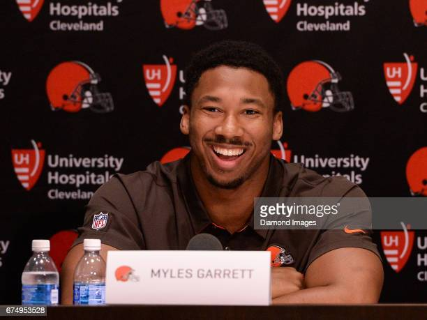 Defensive end Myles Garrett of the Cleveland Browns laughs as he answers questions from the media during a press conference after the first round of...
