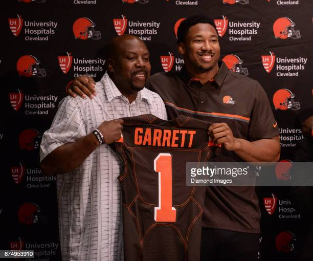 Defensive end Myles Garrett of the Cleveland Browns poses for a picture with his father Lawrence Garrett during a press conference after the first...