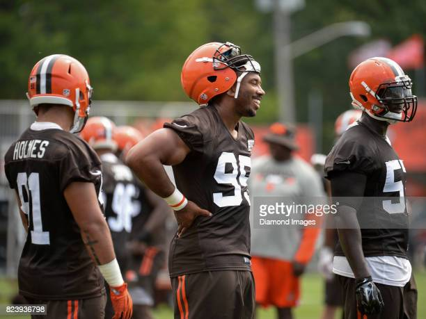 Defensive end Myles Garrett of the Cleveland Browns smiles as he stands on the field during a training camp practice on July 27 2017 at the Cleveland...