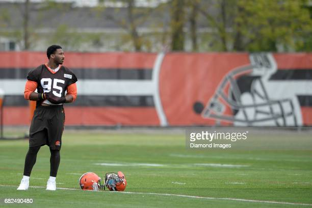 Defensive end Myles Garrett of the Cleveland Browns stands on the field after a rookie mini camp practice on May 12 2017 at the Cleveland Browns...