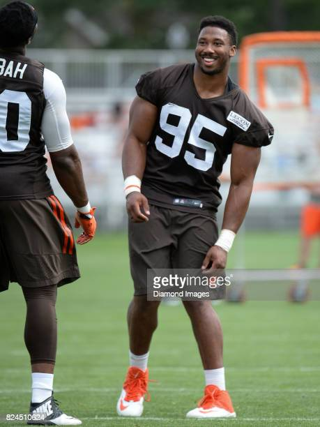 Defensive end Myles Garrett of the Cleveland Browns stands on the field during a training camp practice on July 28 2017 at the Cleveland Browns...