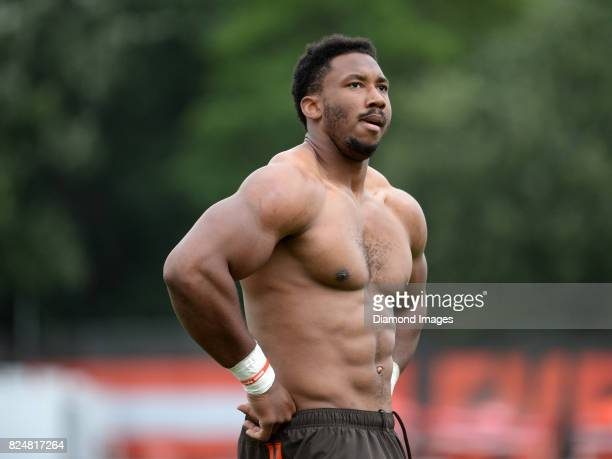 Defensive end Myles Garrett of the Cleveland Browns stands on the field after a training camp practice on July 28 2017 at the Cleveland Browns...