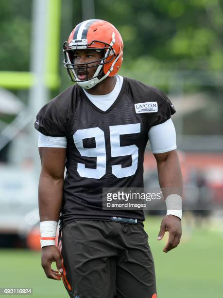 Defensive end Myles Garrett of the Cleveland Browns stands on the field during an OTA practice on June 6 2017 at the Cleveland Browns training...