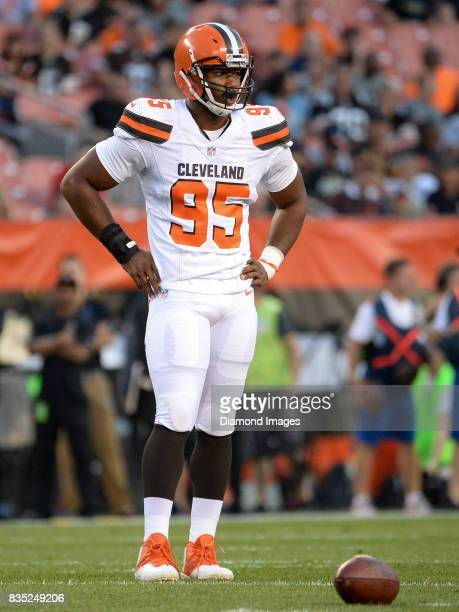 Defensive end Myles Garrett of the Cleveland Browns stands on the field during an injury timeout in the first quarter of a preseason game on August...
