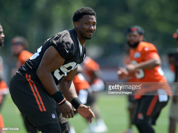 Defensive end Myles Garrett of the Cleveland Browns stretches on the field during a veteran mini camp practice on June 14 2017 at the Cleveland...