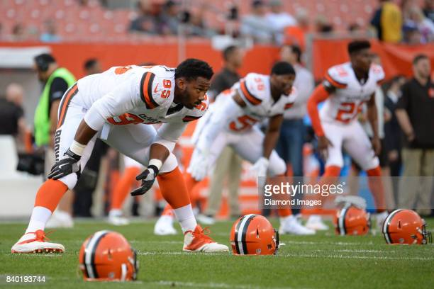 Defensive end Myles Garrett of the Cleveland Browns stretches on the field prior to a preseason game on April 27 2017 against the New York Giants at...