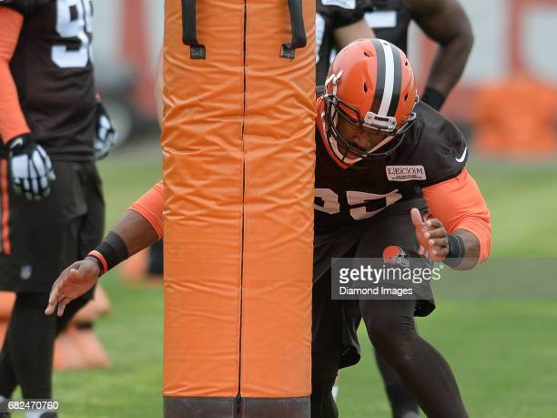 Defensive end Myles Garrett of the Cleveland Browns takes part in a tackling drill during a rookie mini camp practice on May 12 2017 at the Cleveland...