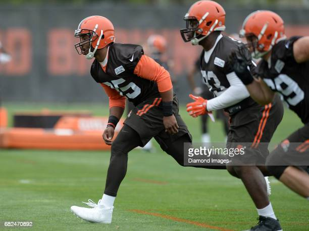 Defensive end Myles Garrett of the Cleveland Browns takes part in a drill during a rookie mini camp practice on May 12 2017 at the Cleveland Browns...