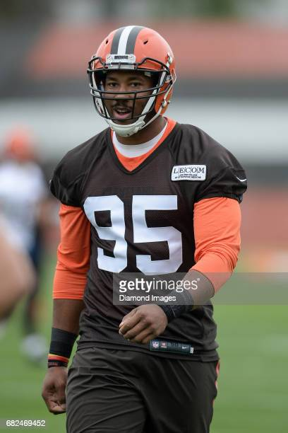 Defensive end Myles Garrett of the Cleveland Browns walks onto the field during a rookie mini camp practice on May 12 2017 at the Cleveland Browns...