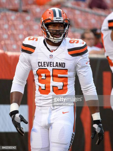 Defensive end Myles Garrett of the Cleveland Browns walks onto the field prior to a preseason game on April 27 2017 against the New York Giants at...