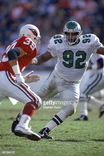 Defensive end Reggie White of the Philadelphia Eagles covers his man during a game against the Phoenix Cardinals on December 22 1990 at Sun Devil...