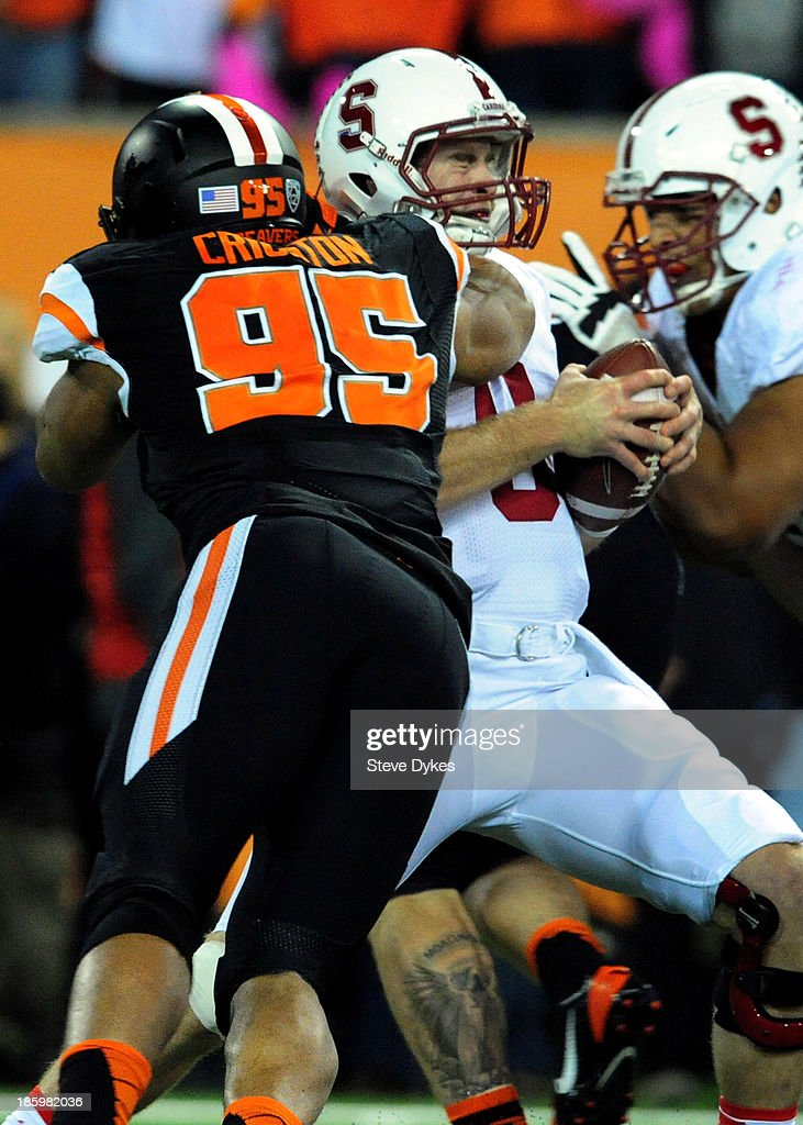 Defensive end Scott Crichton #95 of the Oregon State Beavers sacks quarterback Kevin Hogan #8 of the Stanford Cardinal during the first quarter of the game at Reser Stadium on October 26, 2013 in Corvallis, Oregon.