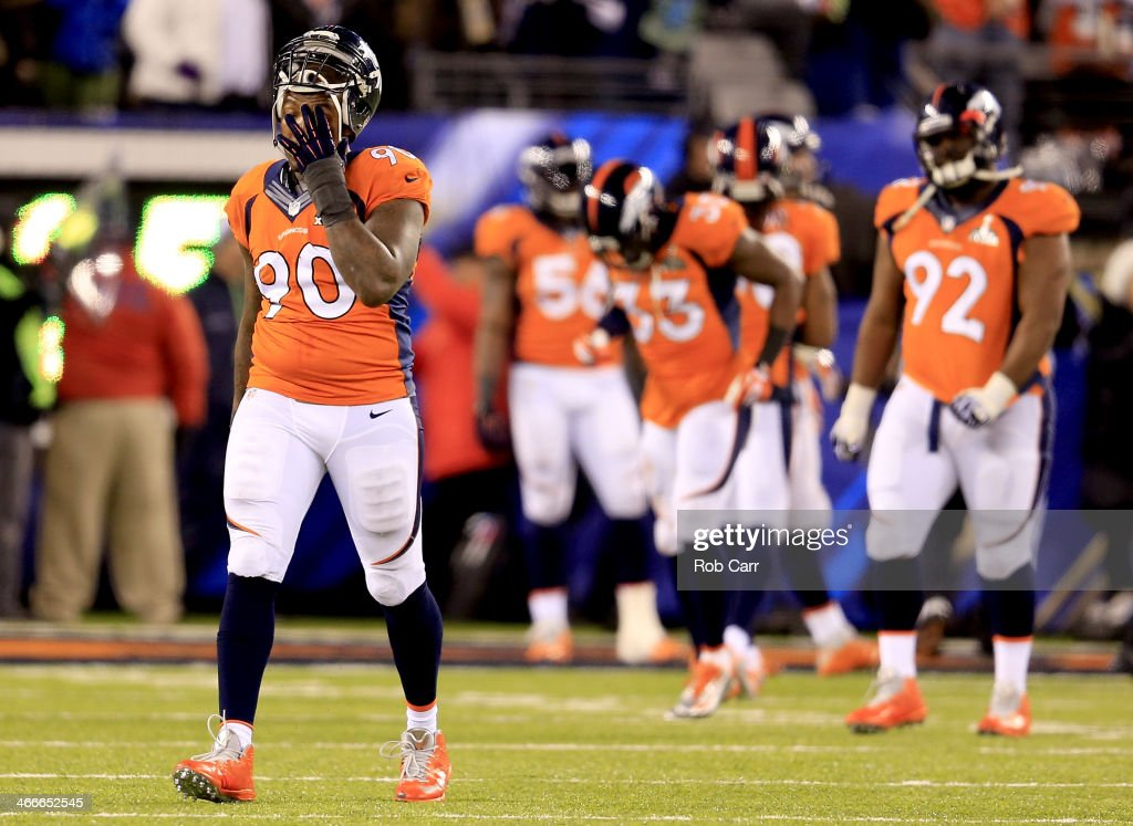 Defensive end Shaun Phillips #90 of the Denver Broncos reacts in the fourth quarter against the Seattle Seahawks during Super Bowl XLVIII at MetLife Stadium on February 2, 2014 in East Rutherford, New Jersey.