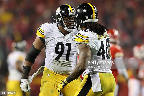 Defensive end Stephon Tuitt of the Pittsburgh Steelers celebrates with outside linebacker Bud Dupree of the Pittsburgh Steelers after a play against...