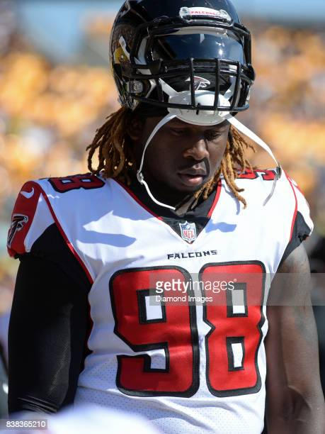 Defensive end Takkarist McKinley of the Atlanta Falcons stands on the sideline in the first quarter of a preseason game on August 20 2017 against the...