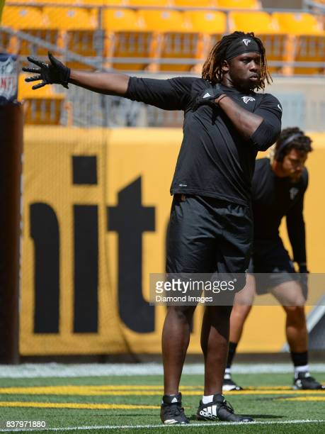 Defensive end Takkarist McKinley of the Atlanta Falcons stretches prior to a preseason game on August 20 2017 against the Pittsburgh Steelers at...