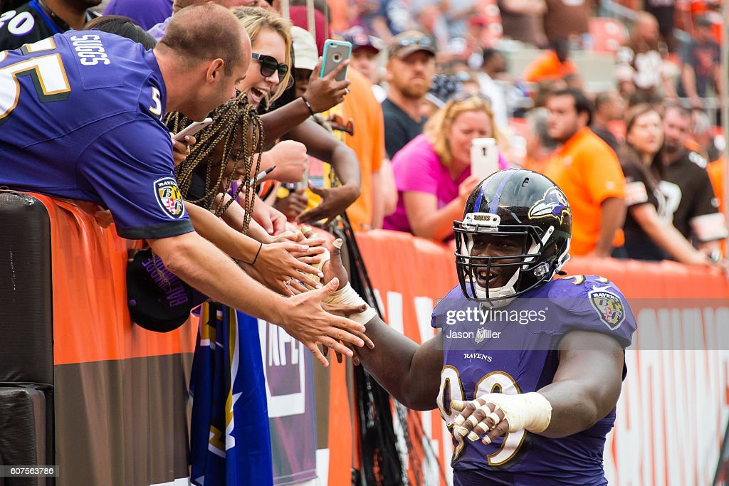 Defensive end Timmy Jernigan #99 of the Baltimore Ravens celebrates with fans after the Ravens defeated the Cleveland Browns at FirstEnergy Stadium on September 18, 2016 in Cleveland, Ohio. The Ravens defeated the Browns 25-20.