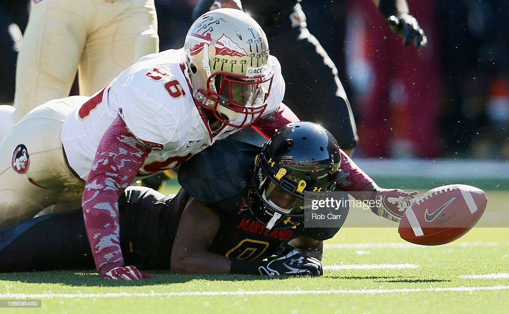 Defensive end Toshmon Stevens #96 of the Florida State Seminoles and kick returner Levern Jacobs #8 of the Maryland Terrapins go after the ball Jacobs fumbled on a kickoff during the first half at Byrd Stadium on November 17, 2012 in College Park, Maryland.