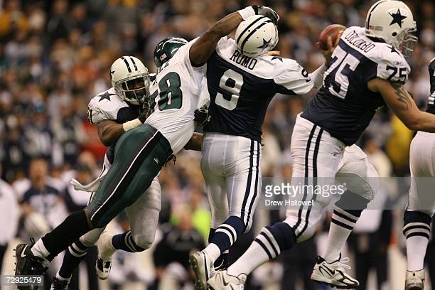 Defensive end Trent Cole of the Philadelphia Eagles hits quarterback Tony Romo of the Dallas Cowboys on December 25 2006 at Texas Stadium in Irving...