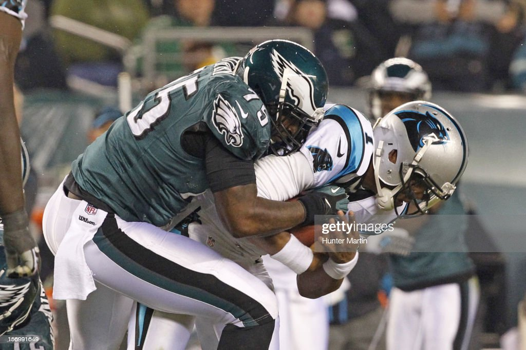 Defensive end Vinny Curry #75 of the Philadelphia Eagles tackles quarterback <a gi-track='captionPersonalityLinkClicked' href=/galleries/search?phrase=Cam+Newton+-+American+Football+Quarterback&family=editorial&specificpeople=4516761 ng-click='$event.stopPropagation()'>Cam Newton</a> #1 of the Carolina Panthers during a game on November 26, 2012 at Lincoln Financial Field in Philadelphia, Pennsylvania. The Panthers won 30-22.