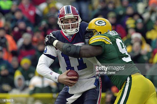 Defensive end Vonnie Holliday of the Green Bay Packers sacks quarterback Drew Bledsoe of the Buffalo Bills during their game on December 22 2002 at...