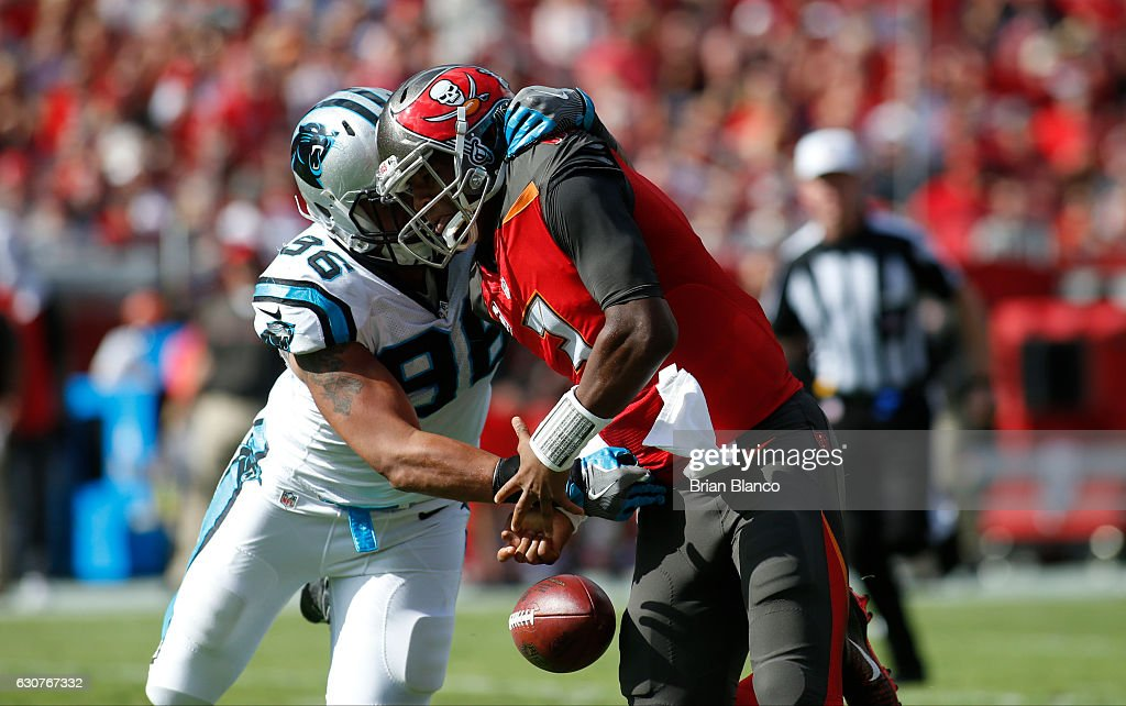Defensive end Wes Horton #96 of the Carolina Panthers forces the fumble by quarterback Jameis Winston #3 of the Tampa Bay Buccaneers for a the turnover during the second quarter of an NFL game on January 1, 2017 at Raymond James Stadium in Tampa, Florida.