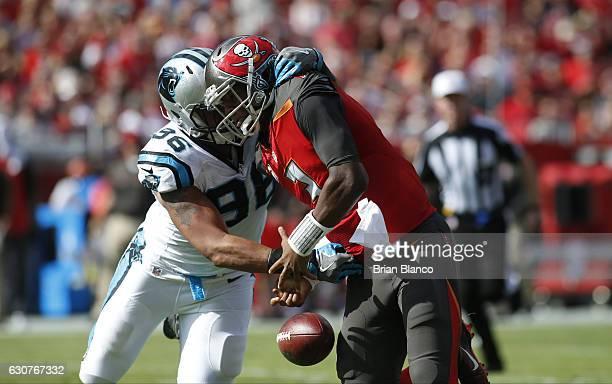 Defensive end Wes Horton of the Carolina Panthers forces the fumble by quarterback Jameis Winston of the Tampa Bay Buccaneers for a the turnover...