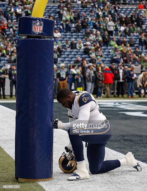 Defensive end William Hayes of the St Louis Rams kneels at the goalpost prior to the game against the Seattle Seahawks at CenturyLink Field on...