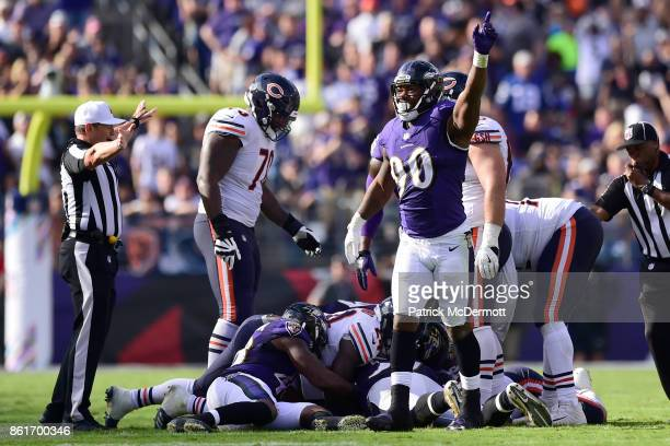 Defensive End Za'Darius Smith of the Baltimore Ravens celebrates after a turnover in the fourth quarter against the Chicago Bears at MT Bank Stadium...