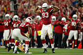 Defensive ends Calais Campbell and Frostee Rucker of the Arizona Cardinals celebrate after a sack on quarterback Aaron Rodgers of the Green Bay...