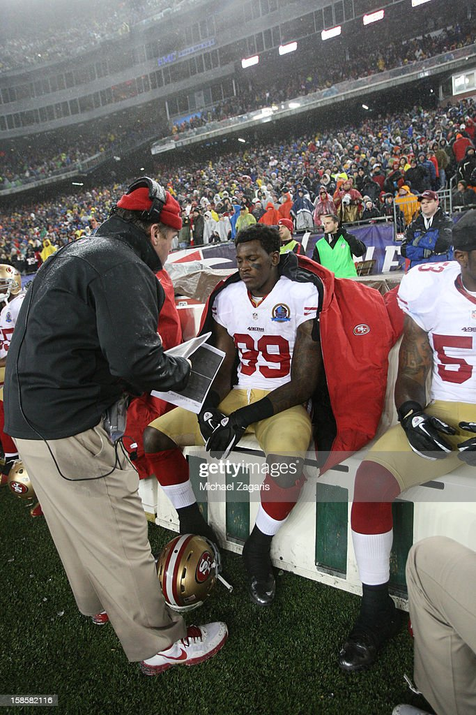 Defensive Line Coach Jim Tomsula of the San Francisco 49ers talks with Aldon Smith #99 during the game against the New England Patriots at Gillette Stadium on December 16, 2012 in Foxboro, Massachusetts. The 49ers defeated the Patriots 41-31.