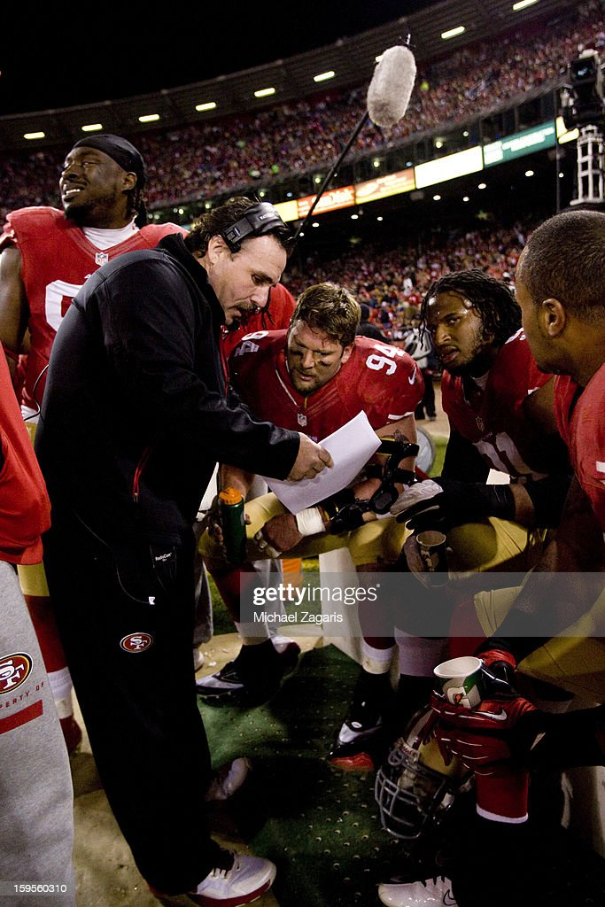 Defensive Line Coach Jim Tomsula of the San Francisco 49ers talks with Justin Smith #94, Ray McDonald #91 and Ricky Jean Francois #95 during the game against the Green Bay Packers at Candlestick Park on January 12, 2012 in San Francisco, California. The 49ers defeated the Packers 45-31.