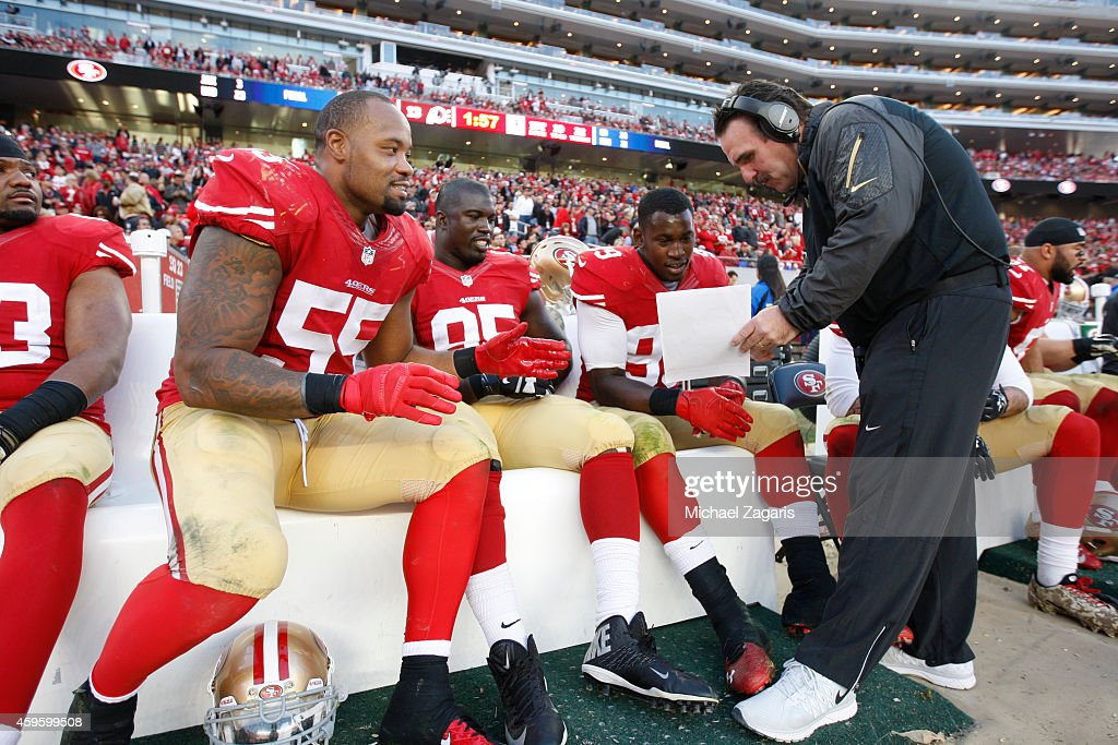Defensive Line Coach <a gi-track='captionPersonalityLinkClicked' href=/galleries/search?phrase=Jim+Tomsula&family=editorial&specificpeople=4355594 ng-click='$event.stopPropagation()'>Jim Tomsula</a> of the San Francisco 49ers talks with <a gi-track='captionPersonalityLinkClicked' href=/galleries/search?phrase=Ahmad+Brooks&family=editorial&specificpeople=2326499 ng-click='$event.stopPropagation()'>Ahmad Brooks</a> #55, <a gi-track='captionPersonalityLinkClicked' href=/galleries/search?phrase=Tank+Carradine&family=editorial&specificpeople=10915724 ng-click='$event.stopPropagation()'>Tank Carradine</a> #95 and <a gi-track='captionPersonalityLinkClicked' href=/galleries/search?phrase=Aldon+Smith&family=editorial&specificpeople=6522981 ng-click='$event.stopPropagation()'>Aldon Smith</a> #99 during the game against the Washington Redskins at Levi Stadium on November 23, 2014 in Santa Clara, California. The 49ers defeated the Redskins 17-13.