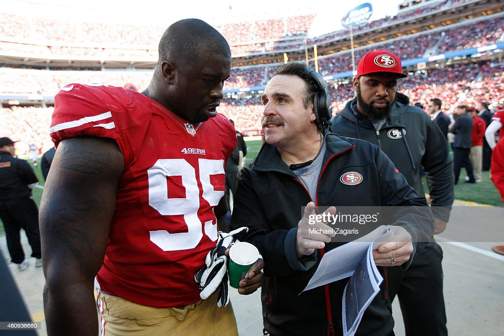 Defensive Line Coach <a gi-track='captionPersonalityLinkClicked' href=/galleries/search?phrase=Jim+Tomsula&family=editorial&specificpeople=4355594 ng-click='$event.stopPropagation()'>Jim Tomsula</a> of the San Francisco 49ers talks with <a gi-track='captionPersonalityLinkClicked' href=/galleries/search?phrase=Tank+Carradine&family=editorial&specificpeople=10915724 ng-click='$event.stopPropagation()'>Tank Carradine</a> #95 during the game against the Arizona Cardinals at Levi Stadium on December 28, 2014 in Santa Clara, California. The 49ers defeated the Cardinals 20-17.