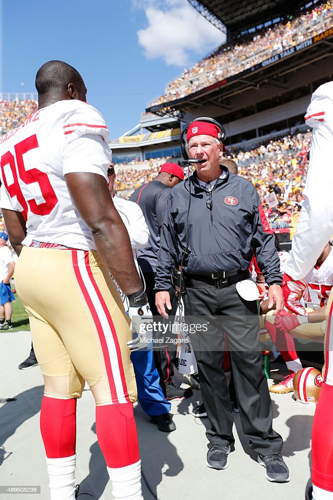 Defensive Line Coach Scott Brown of the San Francisco 49ers talks with <a gi-track='captionPersonalityLinkClicked' href=/galleries/search?phrase=Tank+Carradine&family=editorial&specificpeople=10915724 ng-click='$event.stopPropagation()'>Tank Carradine</a> #95 during the game against the Pittsburgh Steelers at Heinz Field on September 20, 2015 in Pittsburgh, Pennsylvania. The Steelers defeated the 49ers 43-18.