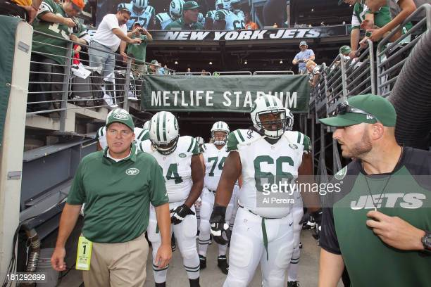 Defensive line/Linebackers assistant coach Jeff Weeks and Head Strength and Conditioning Coach Justus Galac of the New York Jets lead the team out of...