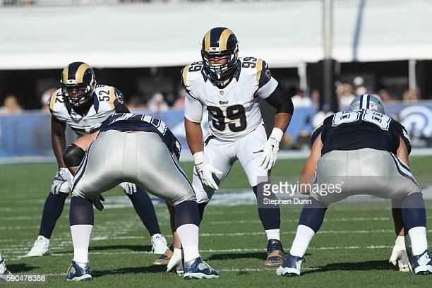 Defensive lineman Aaron Donald of the Los Angeles Rams lines up against the Dallas Cowboys at the Los Angeles Coliseum during preseason on August 13...