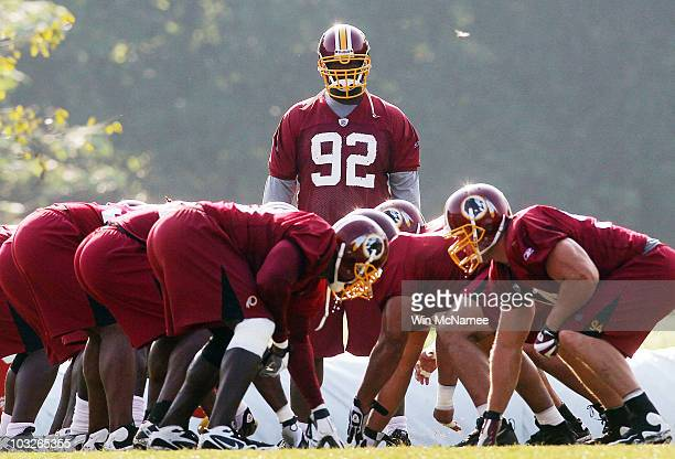 Defensive lineman Albert Haynesworth of the Washington Redskins watches his teammates practice as he sits out his eighth consecutive day of practice...