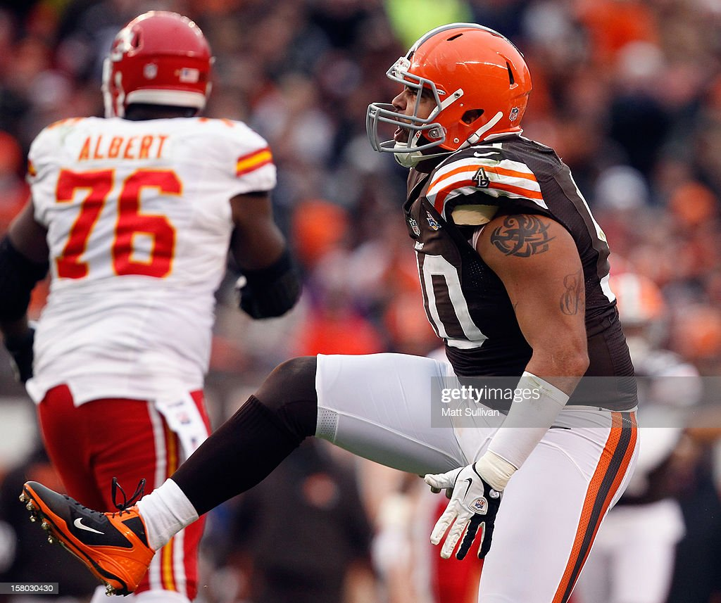 Defensive lineman Billy Winn #90 of the Cleveland Browns celebrates after a sack as tackle Branden Albert #76 of the Kansas City Chiefs at Cleveland Browns Stadium on December 9, 2012 in Cleveland, Ohio.