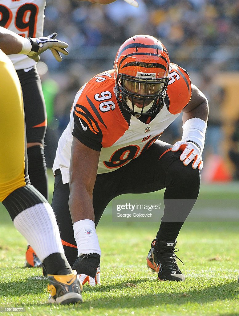 Defensive lineman Carlos Dunlap #96 of the Cincinnati Bengals looks on from the line of scrimmage during a game against the Pittsburgh Steelers at Heinz Field on December 23, 2012 in Pittsburgh, Pennsylvania. The Bengals defeated the Steelers 13-10.
