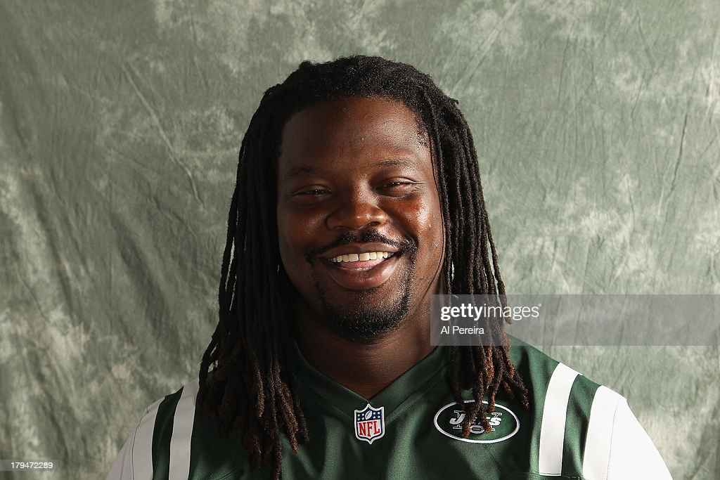 Defensive Lineman Damon Harrison #94 of the New York Jets poses during a portrait session on September 1, 2013 in Florham Park, New Jersey.