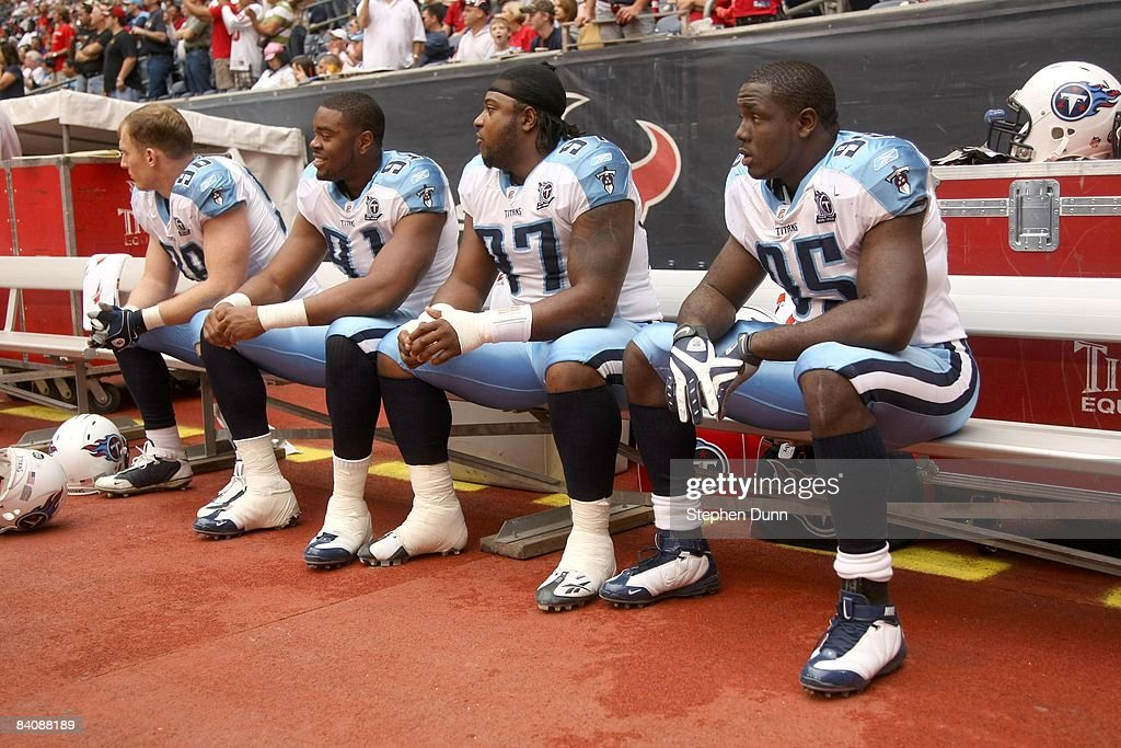 Defensive lineman Dave Ball #98, Jason Jones #91, Tony Brown #97 and William Hayes #95 of the Tennessee Titans sit on the bench before the game against the Houston Texans on December 14, 2008 at Reliant Stadium in Houston, Texas.