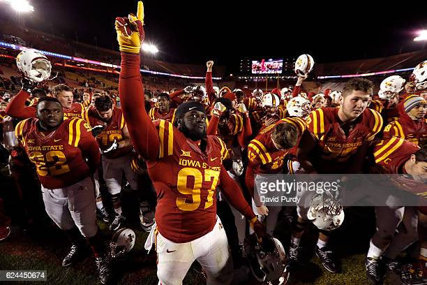 Defensive lineman Demond Tucker of the Iowa State Cyclones celebrates with his teammates after they defeated the Texas Tech Red Raiders 6610 at Jack...
