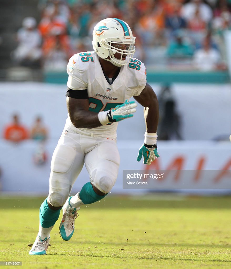 Defensive lineman <a gi-track='captionPersonalityLinkClicked' href=/galleries/search?phrase=Dion+Jordan&family=editorial&specificpeople=6161243 ng-click='$event.stopPropagation()'>Dion Jordan</a> #95 of the Miami Dolphins lines up against the Atlanta Falcons at Sun Life Stadium on September 22, 2013 in Miami Gardens, Florida. The Dolphins defeated the Falcons 27-23.