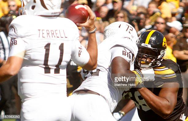 Defensive lineman Faith Ekakitie of the Iowa Hawkeyes battles during the third quarter offensive lineman Taylor Moton of the Western Michigan Broncos...