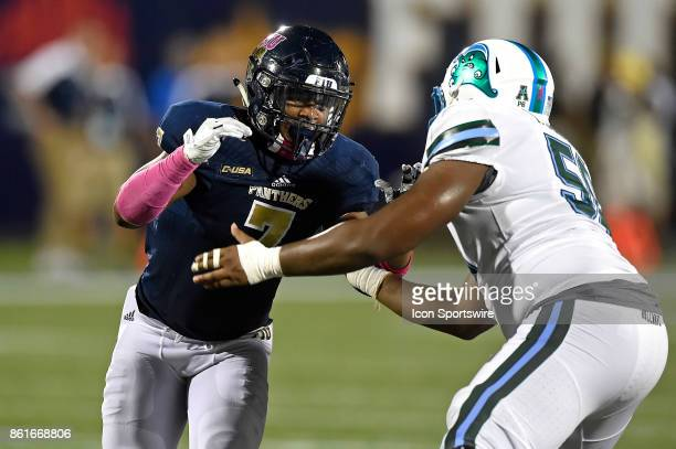FIU defensive lineman Fermin Silva attempts to get around Tulane offensive lineman Tyler Johnson in the third quarter as the FIU Golden Panthers...