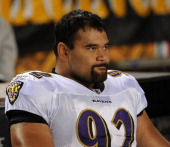 Defensive lineman Haloti Ngata of the Baltimore Ravens looks on from the sideline during a game against the Pittsburgh Steelers at Heinz Field on...