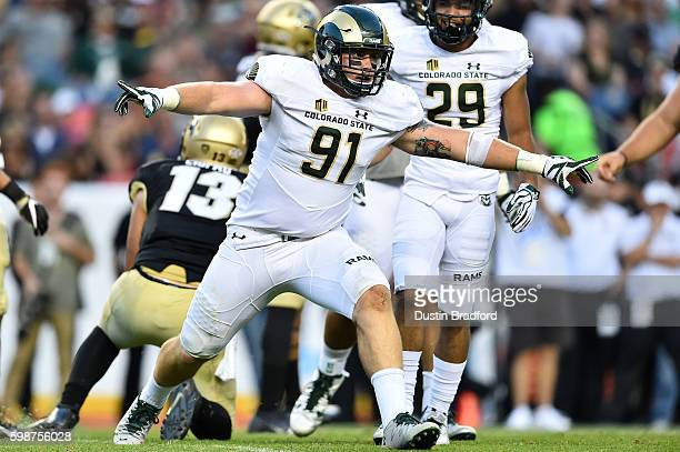 Defensive lineman Jakob Buys of the Colorado State Rams celebrates after a sack against the Colorado Buffaloes in the first half of a game at Sports...
