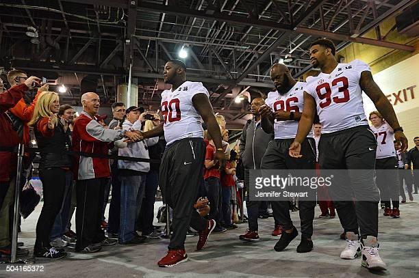 defensive lineman Jarran Reed defensive lineman A'Shawn Robinson and defensive lineman Jonathan Allen of the Alabama Crimson Tide enter Media Day for...